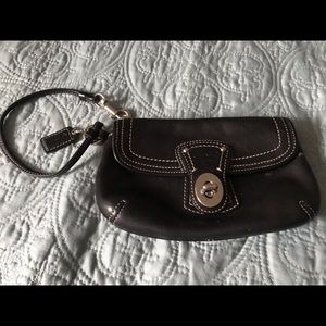 Coach Authentic Leather Lock turn wristlet